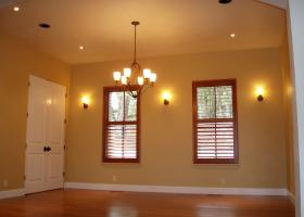 Formal Dining room with wood shutters.