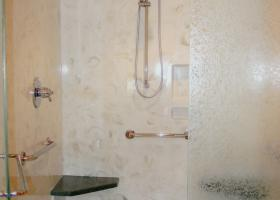 Multi use grab bar locations with seating and chair turn around. Slide bar shower head and hand held option.
