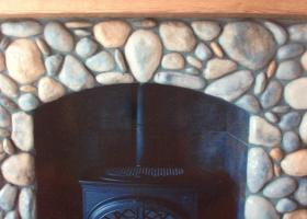 Rock fireplace with woodstove