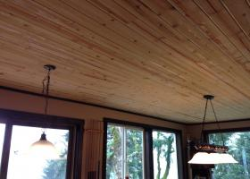 1400 sq. ft. of T&G pine with satin lacquer finish. Future work: Beams