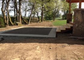 Concrete with boarder trim.