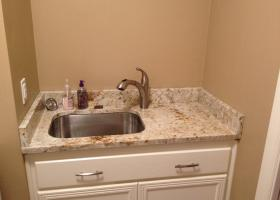 After: granite counter-top and splash, sink and faucet.