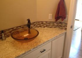 After: granite counter-top, deco splash, vessel sink, new faucet