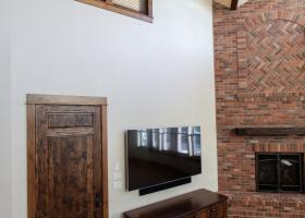 Floor-ceiling brick fireplace with unique mantle