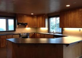 Kitchen with wrap-around counters and custom cabinets